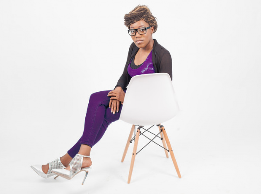 Kole Purple Sitting in Chair